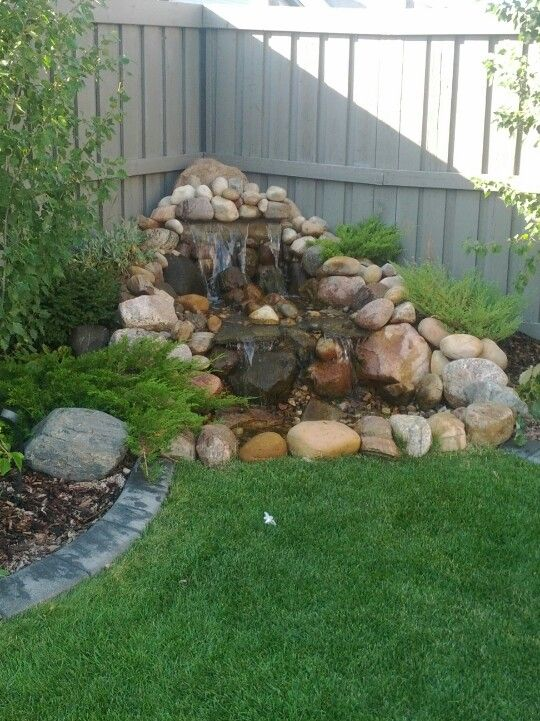 Pondless waterfall...maybe we could just dig up that little pond and fix it like this???