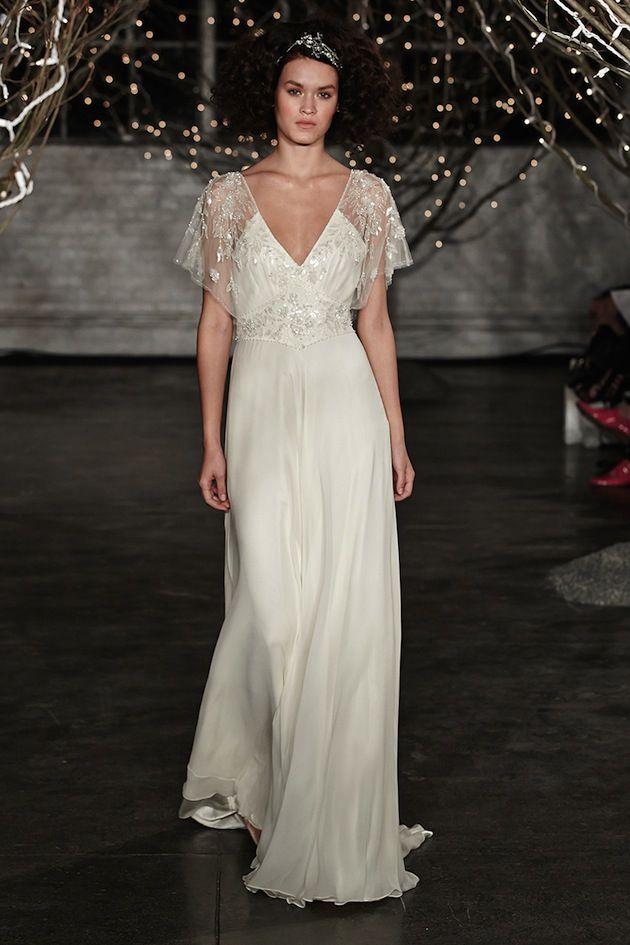 love the sheer angel sleeves on this wedding dress
