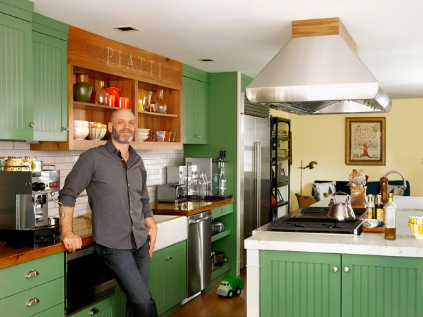Marc Vetri's Kitchen : Chef Marc Vetri has four Italian restaurants, but his home kitchen in a renovated 1800s Philadelphia townhouse might as well be his fifth. It was built for cranking out big meals for friends and family, with an enormous marble island, two sinks, a 60-inch Wolf range with a grill and flat top, an industrial espresso machine and even sparkling water on tap. via Food Network