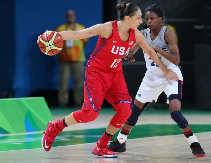 US beats France 86-67, advances to women's basketball final:  August 19, 2016  -     Aug 18, 2016; Rio de Janeiro, Brazil; USA guard Diana Taurasi (12) handles the ball against France point guard Olivia Epoupa (22) during the women's basketball semifinals in the Rio 2016 Olympic Games at Carioca Arena 1.