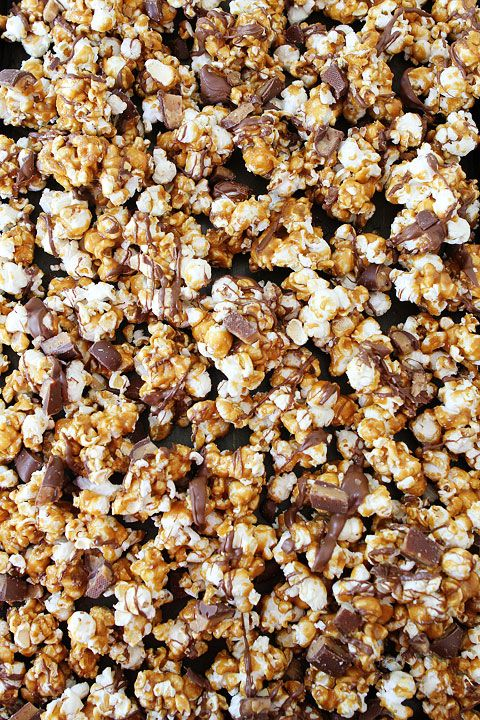 Butter Toffee Heath Popcorn Recipe on twopeasandtheirpod.com We LOVE this sweet popcorn! It makes a great gift and is perfect for holiday parties!