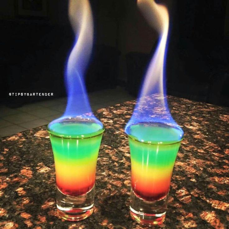 Flaming Rainbows Watch us make Rainbow Shots: https://youtu.be/MoVZoCmkdjY FLAMING RAINBOWS Grenadine Orange Juice Vodka Club Soda Blue Food Coloring Bacardi 151 Instagram Photo Credit: @louthebartender #cocktail #drink #vodka #rum #rainbow #fire