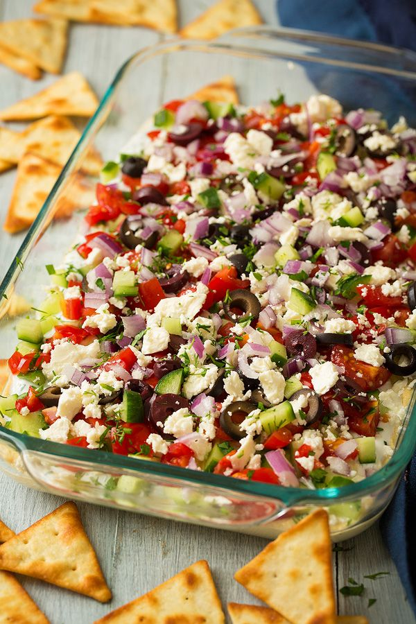 Greek Seven Layer Dip | Cooking Classy  I would make this dairy free by subbing dairy free yogurt or guac instead.