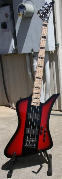 This four-string David Ellefson Kelly Bird bass features a basswood body with Ellefson's signature red pinstripe finish. The bolt-on bound maple neck has 21 jumbo frets and block inlays, EMG® pickups, two volume controls and three-band active EQ, Jackson high-mass four-string HM-4 bridge, and Jackson die-cast tuners.    Model Name:Dave Ellefson Kelly Bird IV, Maple Fingerboard, Red StripeModel Number:2919191590Series:Artist SignatureMSRP:$684.92Color:Red StripeB...