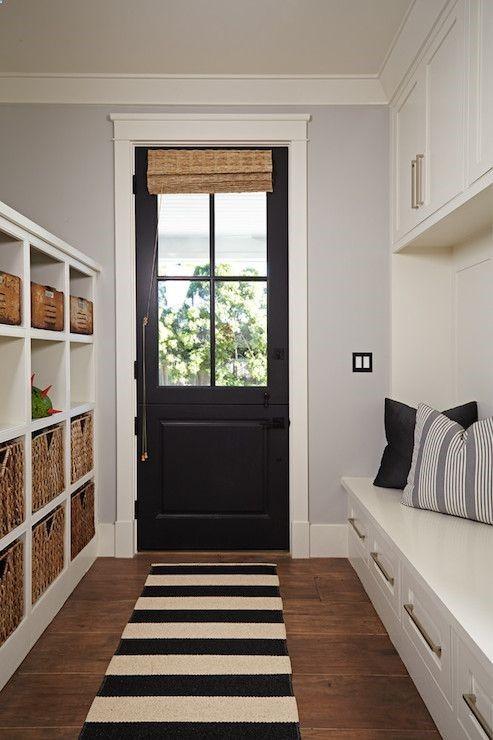 Brooke Wagner Design - laundry/mud rooms - mudroom, long mudroom, galley mudroom, mudroom ideas, mudroom door, black door, suspended cabinet...