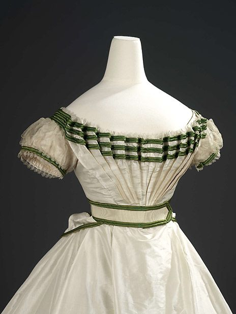 """Girls evening dress bodice, 1867.  (I want to replicate this on an adult size dress, especially because the wedge of pleating will """"draw in"""" the waist.)"""