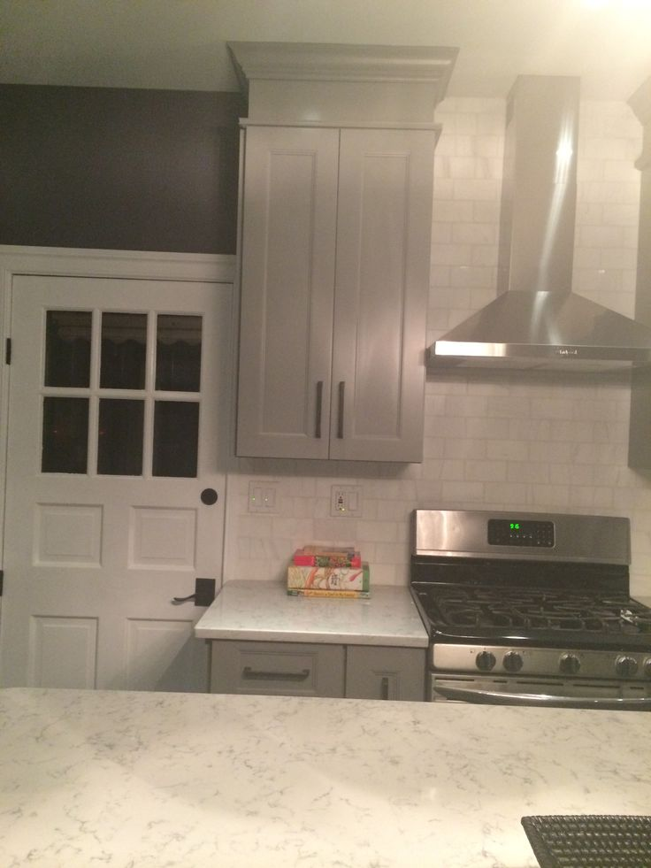 White Kitchen Cabinets Countertop Backsplash And Floor