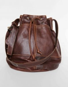 Stunning genuine brown leather handbag in Tobacco color lined with beautiful fabric. From the Thandana Collection. Buy it from Wave2Africa - an online gift and decor boutique.