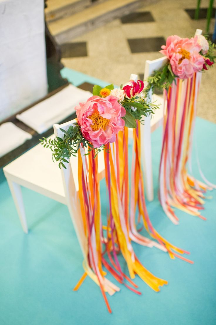 Wedding chairs decorated with fresh flowers and colourful ribbons | Photography by http://www.giuliegiordi.com/
