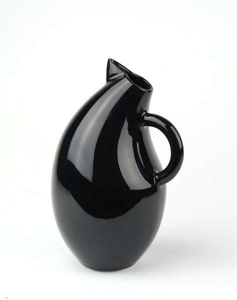 Storybirds range, Olga shape  Object: Jug (Pitcher)  Place of origin: Finland (made)  Date: 1993 (designed)  1995 (made)  Artist/Maker: Tuominen-Niittylä, Kati, born 1947 (born 1947, designer)  Arabia factory (Hackman is the parent company to Arabia, manufacturer)  Materials and Techniques: White high-fired industrial earthenware, black glaze, cast