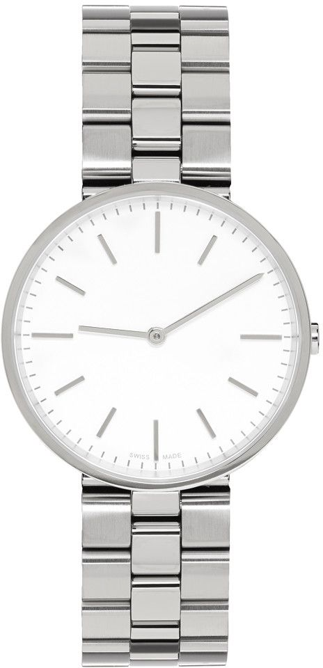 Swiss-made polished and brushed stainless steel two-hand watch in silver-tone. Signature lug-less 'M-line' case. Flat, scratch-resistant sapphire crystal lens at circular face. Ronda 762 quartz movement. Mirror-polished aluminium hands. Markers in silver-tone. Brushed stainless steel three-link strap in silver-tone with folding clasp fastening. Water resistant up to 50 meters. Approx. 37 mm diameter, 9.5mm width.