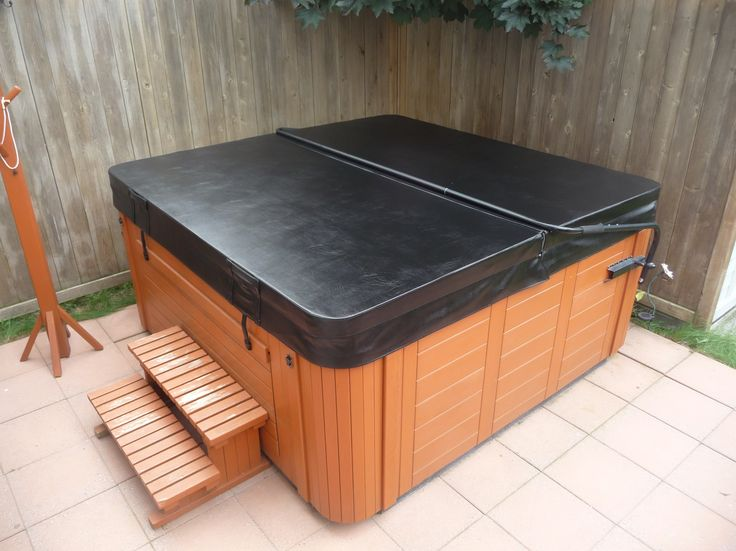 Great looking new hot tub cover and lifter setup from The Cover Guy www.thecoverguy.com