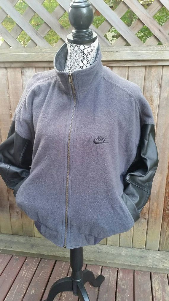 Check out this item in my Etsy shop https://www.etsy.com/ca/listing/482120393/vintage-nike-force-jacket-bomber-varsity