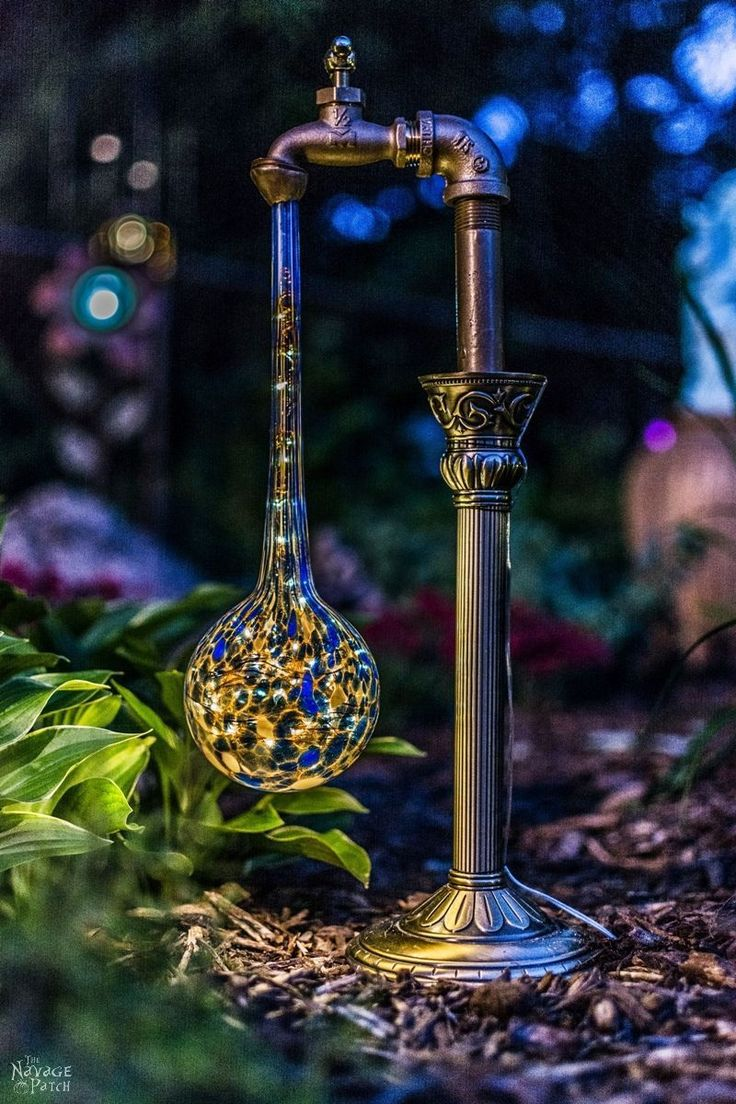 2017/06/26 DIY Waterdrop Solar Lights | Easy, budget friendly and one of a kind DIY backyard ornaments and landscape lights | Upcycled candle sticks | Upcycled plant watering globes | Step-by-step tutorial for DIY waterdrop solar lights | DIY whimsical garden lights | Before & After | TheNavagePatch.com