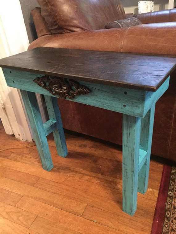 This is the perfect addition to your home furnishings!! The reclaimed wood end table/side table is large enough to hold just what you need but small enough to fit anywhere in any room! This table pairs perfectly with our coffee table that that is listed in our shop as well!! It measures approximately 24 x 11 x 22 high. It has distressed teal frame with a dark stained distressed top. We can customize it to any size or color youd like!!  Here at Mtnmetalworks....we make, repurpose, or…