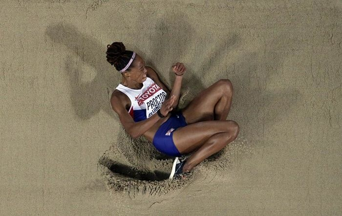World Athletics Championships 2015: day seven – in pictures | Sport | Britain's Shara Proctor lands in the sand on her way to winning silver in the women's long jump final
