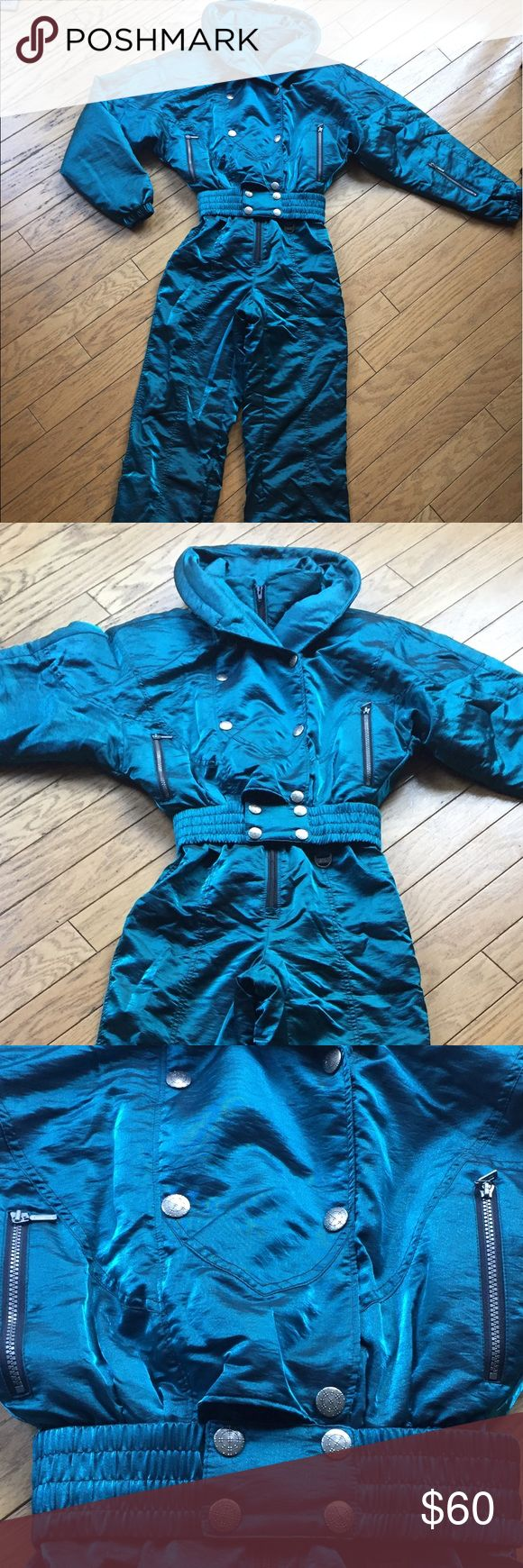 Women's Teal Snow Bunny Skiing Jumpsuit Size 10 High quality metallic shiny teal women's snowboarding and skiing outfit in the classic 1980s snow bunny style. Women's regular size 10. Excellent condition only used a few times, this jump suit is SO comfortable and great for staying warm and dry, sadly too big on me now so I'm selling it even though I wish I didn't have to. Water resistant fabric with lots of lining to keep you cozy. Make me an offer if you're interested! I discount bundles 😘…