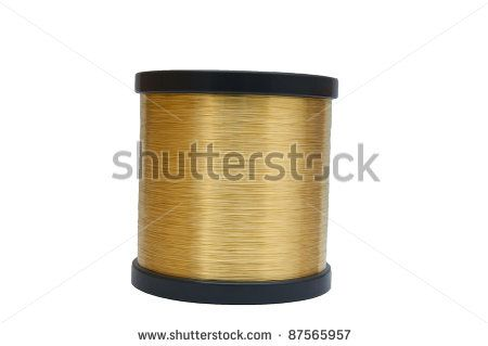 Coiled brass wire. - stock photo