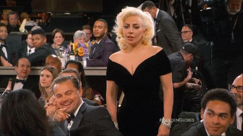 It seems the most talked about moment of the 2016 Golden Globes was not an amazing speech, or a deserving winner, but Leonardo DiCaprio's superb reaction to Lady Gaga barging past him to collect her award. The pop star was on her way to collect the gong for 'American Horror Story: Hotel' when she pushed