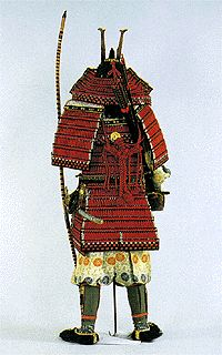 "A ""kuwagata (=hoe-shaped)"" ornament is attached on the helmet as a ""maedate"" (=front ornament) particularly.  A ""sode"" (=protector for shoulder and elbow) and ""kusazuri"" (=protector for the lower abdomen and the thigh) are attached to the armor."