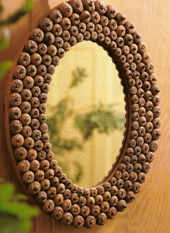 Make an acorn mirror by simply gluing the caps onto a cardboard/ foam board with mirror at the center.