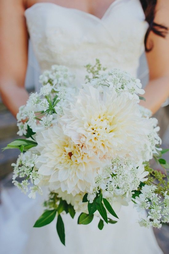Holy shnikeys, this bouquet is awesome. Two big flowers with baby's breath or similar around it.