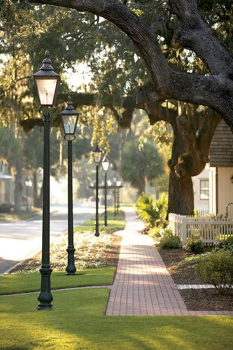 Love the lamp posts near brick sidewalks, mature trees, and white picket fences.