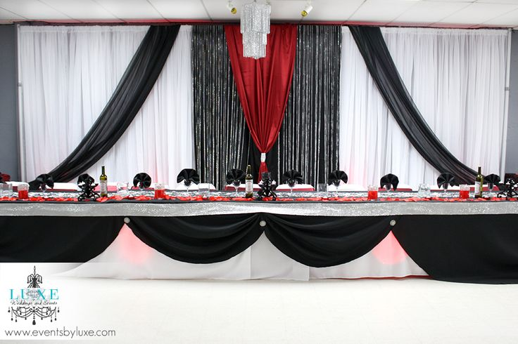 Red and black Backdrop decor from LUXE weddings and events in London Ontario