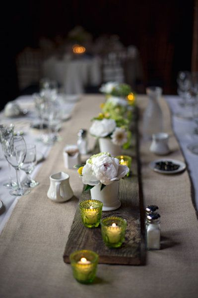 Natural table decorations- lay a board down the middle of the table and decorate with tea lights and minimal flowers