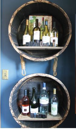 Cut whiskey barrels in half and install as bar shelves.