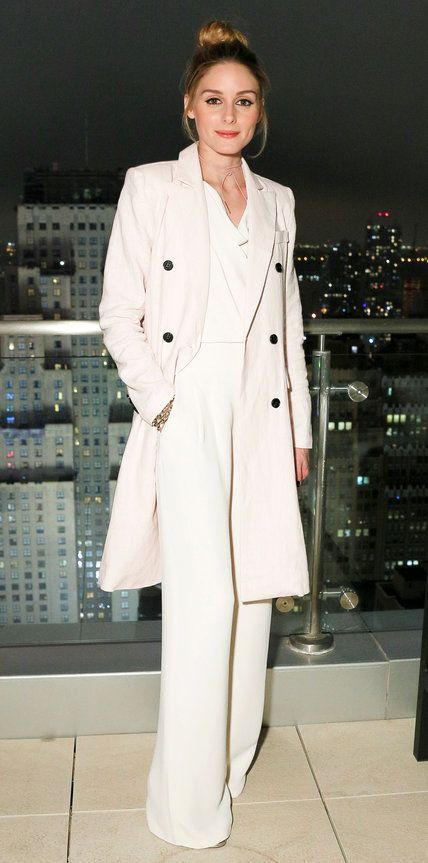 Olivia Palermo in all white outfit with trench and wide leg slacks. See more at www.HerStyledView.com