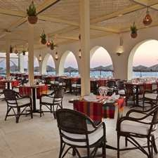 Take in panoramic views of the Red Sea and the Hilton Hurghada Plaza marina at this open-air restaurant on the beach. Sip cocktails at sunset, sitting on sofas draped with Oriental rugs out on the terrace.