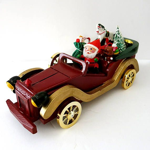 This is a Santa with his toys in a Stutz Bearcat automobile from the 1970s made in Taiwa ROC. There is a sticker on the bottom. It is in very good vintage condition with no issues or missing pieces. Santa looks to be made of wood while the toys and car are plastic. It measues 9 inches long, 3 1/2 inches wide and 4 inches high to the top of the horse. This would be a cute gift for a car enthusiast or a decoration under the tree.