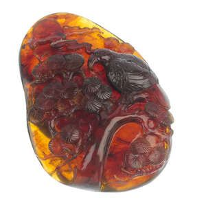 LOT:424 | A natural Burmese amber carving.
