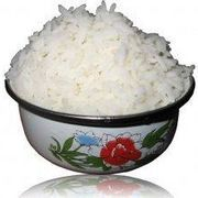 Sticky rice, also known as Japanese rice, becomes sticky when it is cooked, and is used frequently in Japanese cuisine--particularly sushi. However, it can be served with a variety of different dishes. Using this simple method, you can make your own sticky rice in an electric rice cooker. This recipe makes approximately four servings.