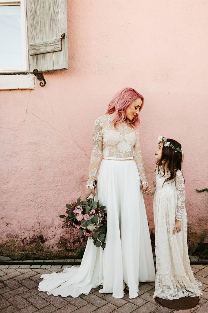 This Race + Religious wedding features eclectic hot pink accents, jaw-dropping reception décor, and totally inspiring cool-girl bridal style.