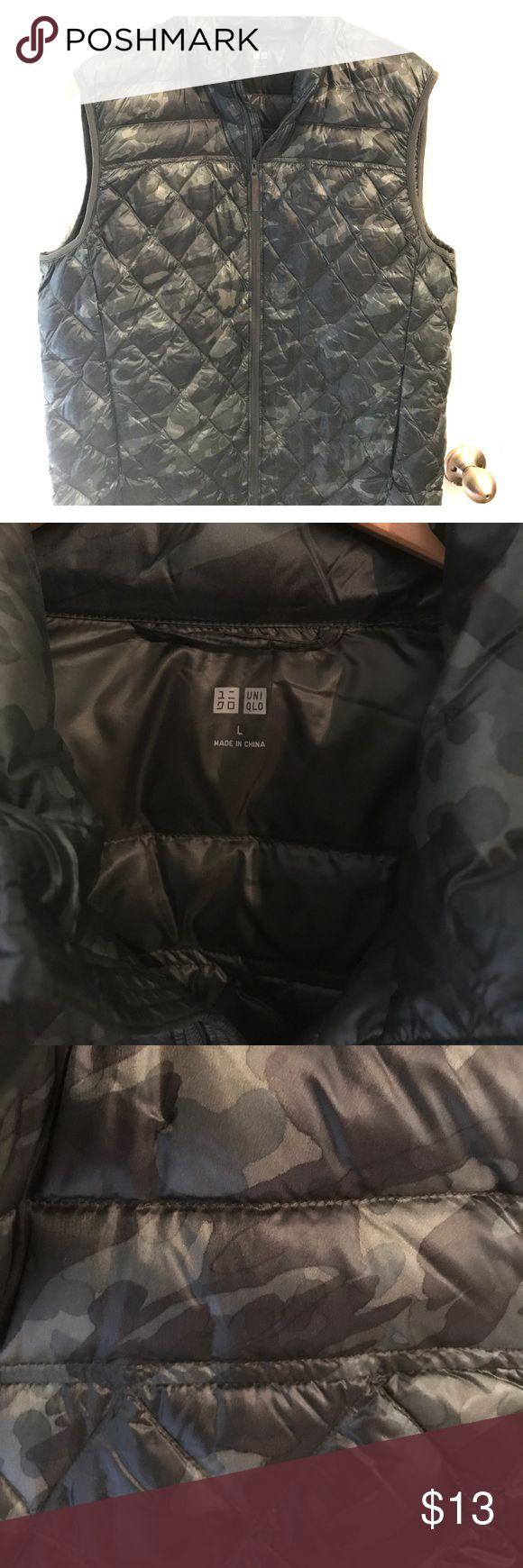 Uniqlo Men's Light Puffer Vest Men's Uniqlo vest. Size large. Worn once. Color is dark green but photos show the faint camo pattern. Uniqlo Jackets & Coats Vests