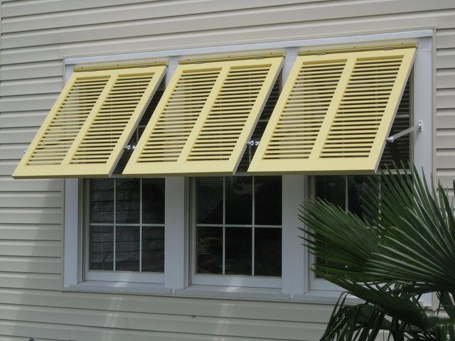 Bahama shutters with adjustable stays (Virginia)