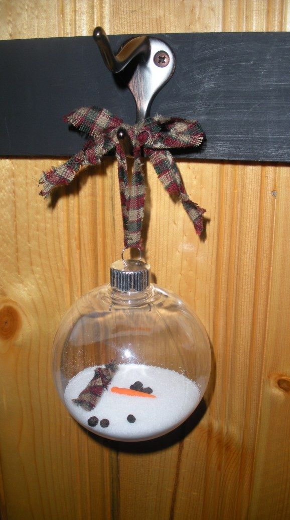 Melted snowman ornament--we added some twig/arms too.  Fun craft the kids helped with.
