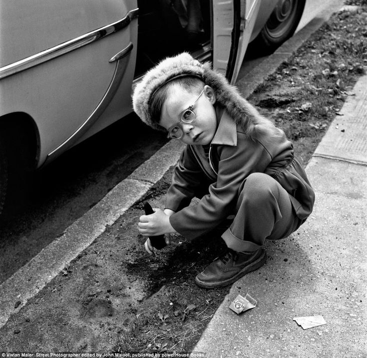 Picturing life: Vivian Maier's captures a little girl playing in the dirt in Chicago. Her pictures, which have been unearthed and are are now appearing in a New York gallery, show a different side of life in America
