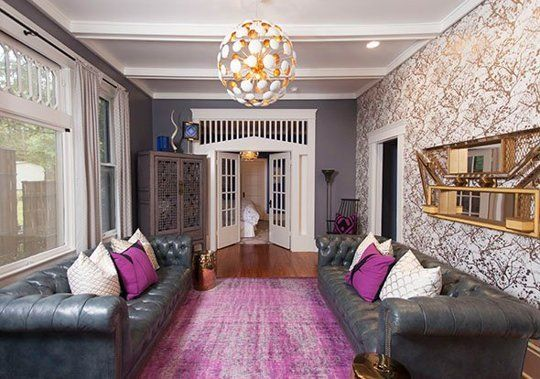 Push Your Style: 7 Bold Ideas from Pros — Professional Projects. Play with purple as inspired by this bold sitting room by Kim West, accented by Ferm Living's gold and white Wilderness Wallpaper.
