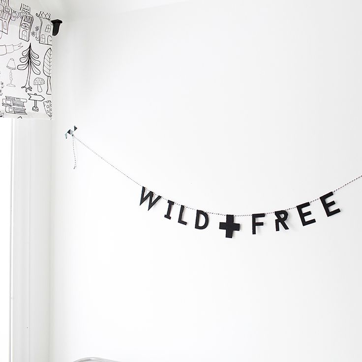 """This garland is made of felt with a string of black and white baker's twine. It features the phrase """"Wild   Free"""" on a string 4 feet in length.The perfect addition to your kid spaces, each letter measures approximately 2 inches.This garland is meant for decoration only, and not as a toy. Please keep out of reach of children. Handmade in Edmonton, Canada."""