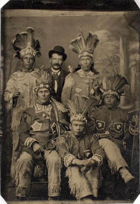 ca. 1875, [tintype portrait of five men in Native American dress, and one in western attire]