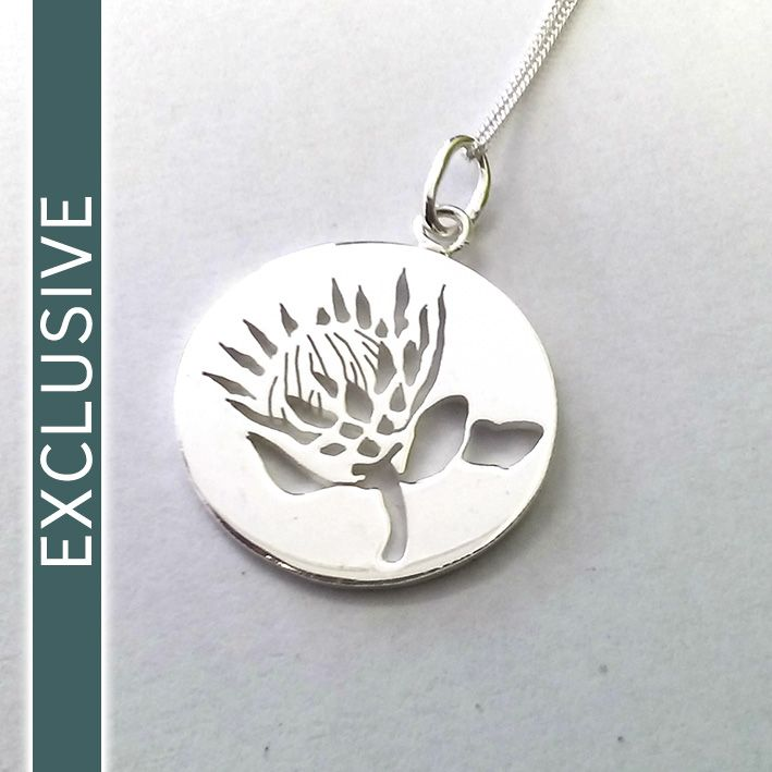 Sterling silver disc with King protea pierced detail on a 45cm chain. Utique online exclusive!