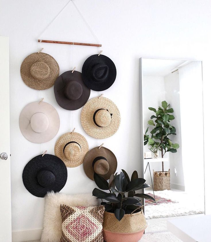 Try something new: Use your accessories as decor. @gypsytan's got it down, keeping her hats organized and walls lookin' fab...A win-win! ⠀  ⠀  Tried something new in your home? Share with #MyPinterest.