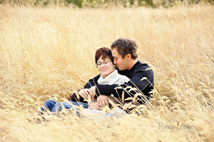 A tender moment at Farwell Canyon fields of golden grass.  Quesnel, Williams Lake and Cariboo BC Engagement Photography Photographer.  Available worldwide.  Engagements | Robyn Louise Photography Engagements | Robyn Louise Photography www.robynlouise.com #engagement #bc #williams #lake #photography #quesnel #cariboo #wedding #photographer #robynlouise