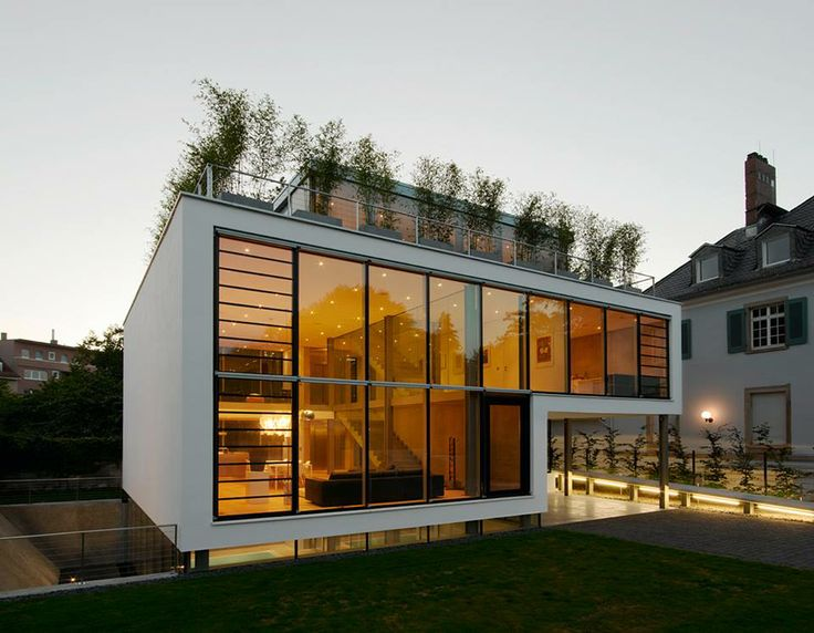 Designed By German Architect Roger Christ And Located In Karlsruhe Germany The Interiors Of This Beautiful Modern Home Can Be Reached Either Via Nort
