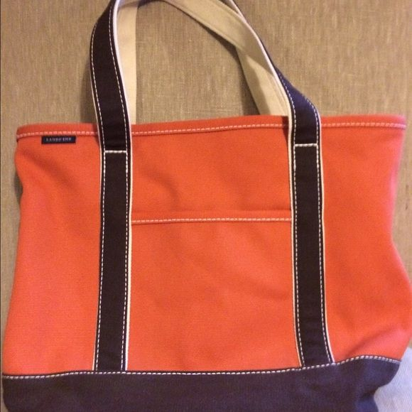 Lands End Orange Tote Lands End Large orange and brown tote.  Has pockets on both sides on inside and a key hook.  Very spacious and in excellent condition. Lands' End Bags Totes