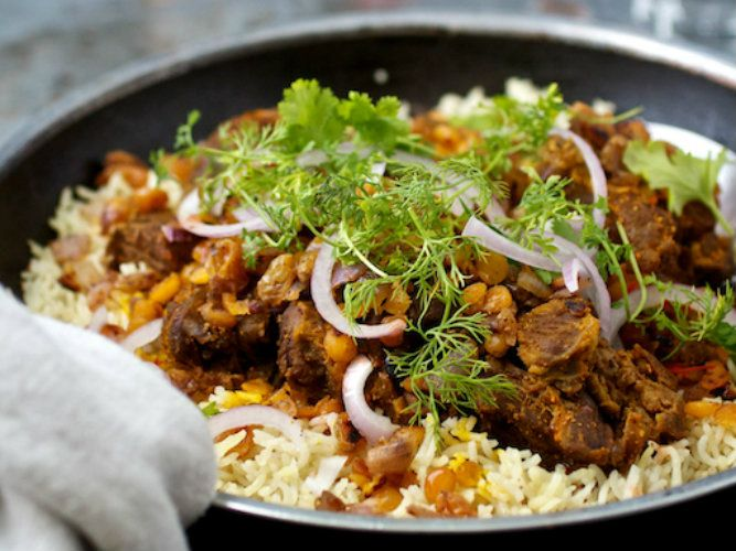 Machboos - National dish of Kuwait. Basmati rice with meat and vegetables served with tomato sauce.