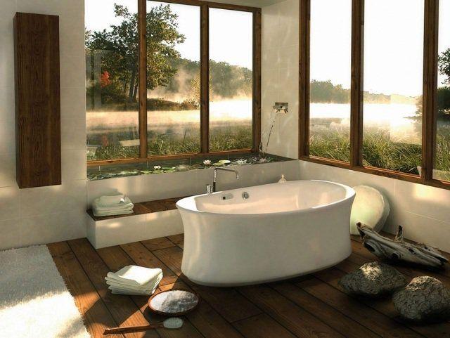 une salle de bain zen avec une baignoire ovale et une petite piscine décorative